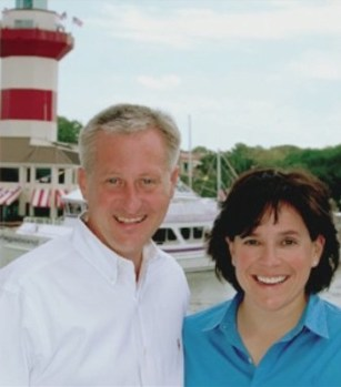 Elizabeth and John Calvert smile in front of an iconic Hilton Head Island lighthouse.