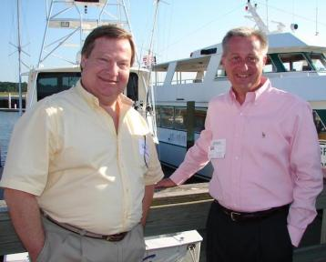 Dennis Gerwing (left) and John Calvert (right) pose together at the marina where The Yellow Jacket was harbored.