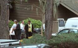 Investigators remove Dennis Gerwing's body from the condo where it was found.