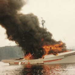 The Investor is shown aflame in the waters outside Fish Egg Island, as discovered by fellow fishing vessel The Casino.