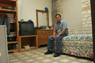 James Harry Reyos sits in his small room in Austin, TX after his release from prison. He was confined to the room during nights and weekends, and monitored with an ankle monitor.