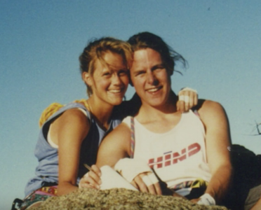 Photo of Amy Wroe Bechtel posing and smiling outdoors with her husband, Steve