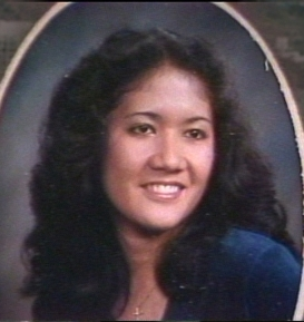 Lisa Au is pictured smiling in an undated studio portrait.