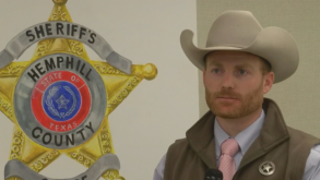 Former Hemphill County Sheriff Nathan Lewis is pictured against a backdrop of the department's logo.