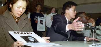 Cindy Song's mother (left) and an attorney representing the song family (front center) are pictured at a press conference, in which they pressed for a more thorough investigation of Cindy's disappearance.