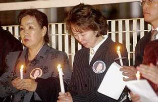 Cindy Song's mother (center) is pictured at a candlelight vigil held soon after Cindy's disappearance. The Song family have endured terrible pain in the wake of Cindy's disappearance.