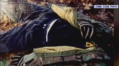 This crime scene photo shows the clothing David was wearing at his time of death, including a USMC sniper hoodie and his USMC-issued field jacket. These clothing items were notable, as David did not like to wear his USMC issued gear in public.