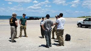 Searchers gathered on South Core Banks after Enrique's disappearance in an attempt to locate the missing paratrooper. (Photo: National Park Service)
