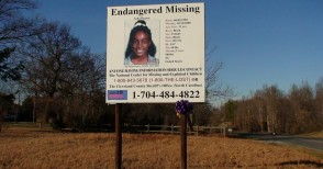 A billboard provides contact information for anyone who has any information about Asha's disappearance.