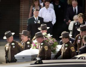 Henry County Sheriff's Deputies serve as pallbearers at Jennifer's funeral. Her remains were discovered more than a month after her abduction. Photo by Natalee Waters / Landmark News Service.