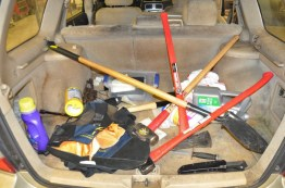"""This police evidence photo shows the inside of Neal Falls' trunk. It's suspected that Falls planned to use this """"murder kit"""" to dispose of the body of Heather, a Charleston woman who he violently attacked. Heather gained control of Falls' gun and shot him in self-defense, ending the life of a suspected serial killer."""