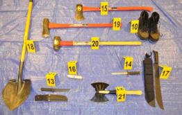 """This police evidence photo shows the contents of Falls' """"murder kit"""" displayed on a tarp."""