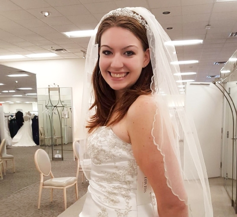 Autumn Lee Stone was 23 years old whenever she died under mysterious circumstances in August of 2019. Days prior to her death, she'd called off her wedding after learning a gut-wrenching secret her fiancé had kept from her. In this family photo, she smiles while trying on a wedding dress (photo by Kjersty Rusch).