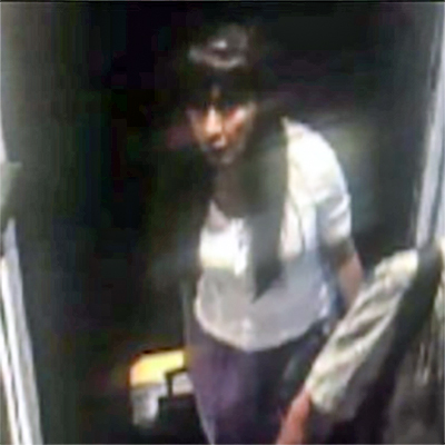 A still image from DFW Airport security footage shows Paula walking within the airport, pulling a bright yellow carry-on suitcase. Neither Paula nor her suitcase have been located since her disappearance on 09-14-2019.