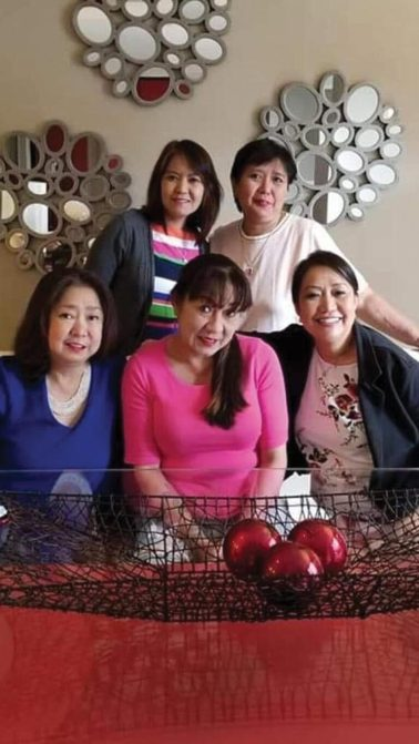 Paula (bottom center) is pictured with her sisters, with whom she's very close. Paula's family have made extensive efforts to search for and bring their sister home.
