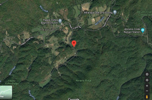 A Google Maps satellite image shows the Happy Valley, TN area. Bell Branch Road (where Mike's farm property was located) is marked with a red indicator.