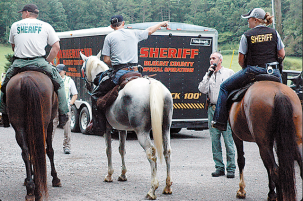 Blount County Sheriff's Department personnel embark upon a horseback search for Mike days after his disappearance. Photo by Knoxville News Sentinel (source article linked below).